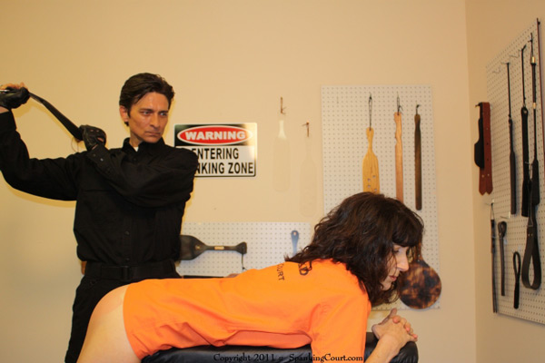 Erica Scott punished by The Villain at the Spanking Court