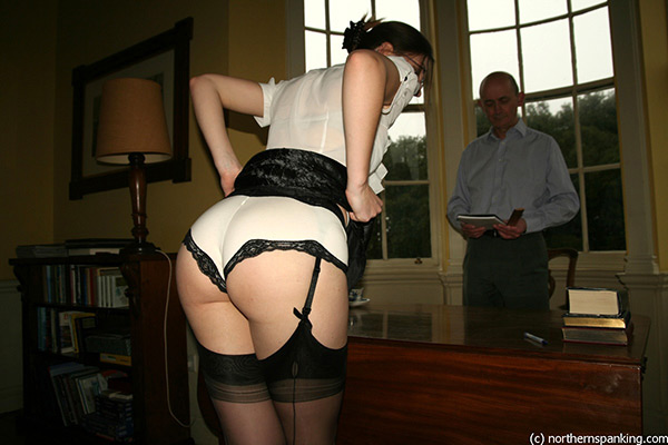 Pandora plays a secretary who gets herself in trouble in her employer's office