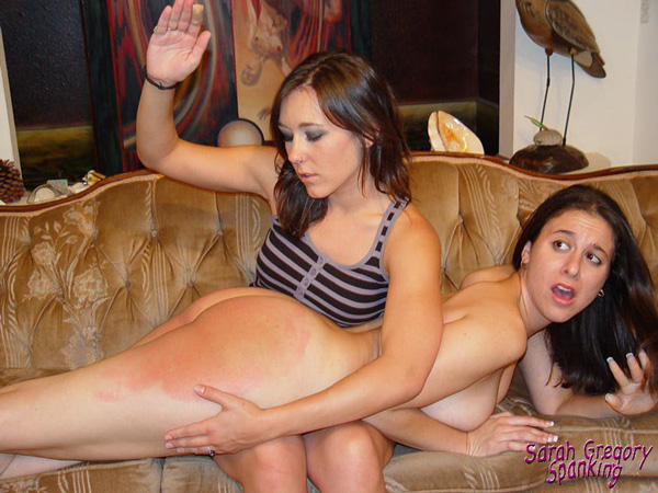 Sinn Sage gives Sarah Gregory a kinky nude lesbian spanking with her hand, belt and paddle