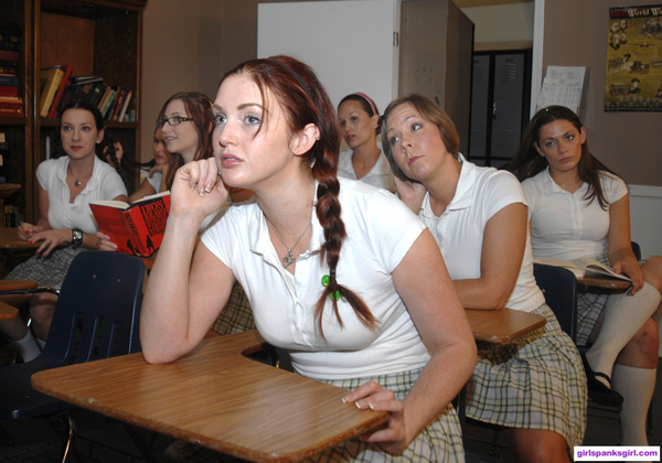 Veronica Ricci sits at the front of class on Clare Fonda's Exclusive Education spanking movie